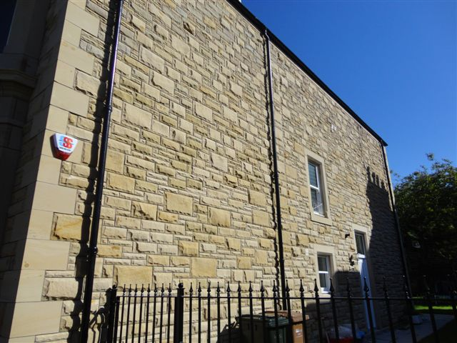 Pitched Sandstone Walling and Quoins by Cumbrian Stone