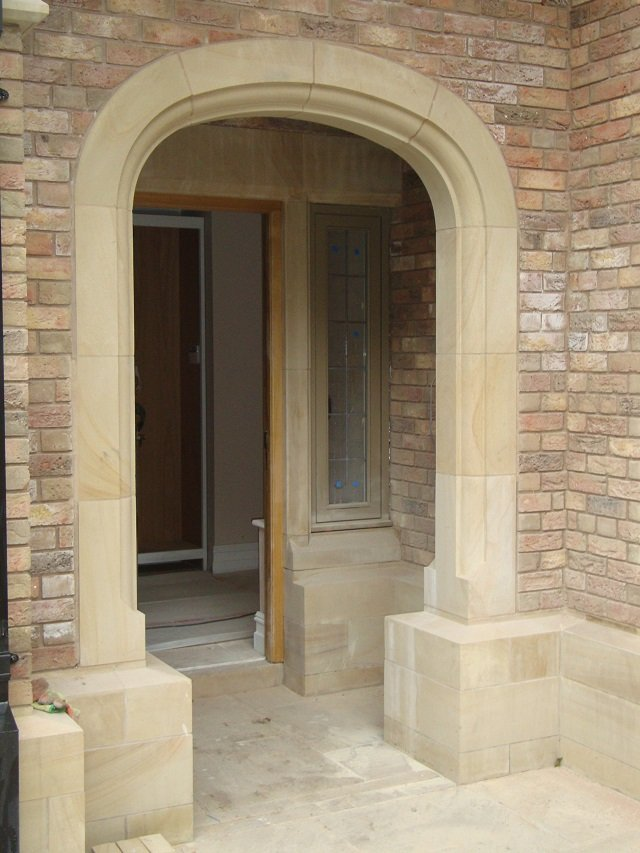 Buff Sandstone Arched Doorway by Cumbrian Stone