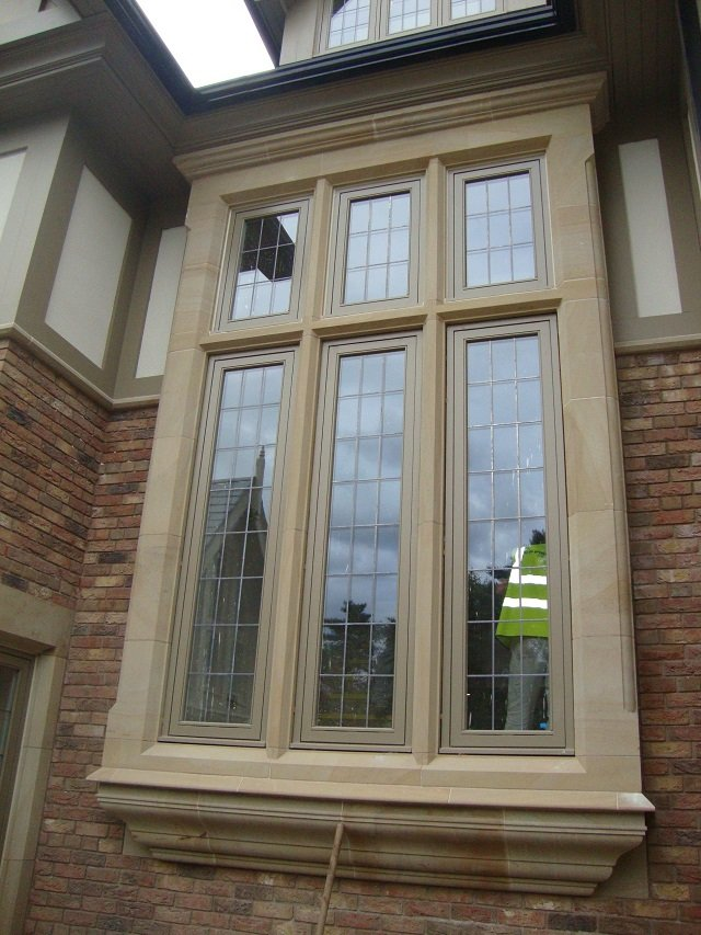 Bespoke Sandstone Feature Window Surround by Cumbrian Stone