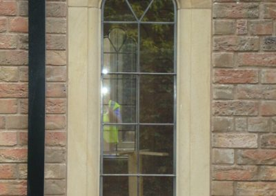 Buff Sandstone Window Surround by Cumbrian Stone