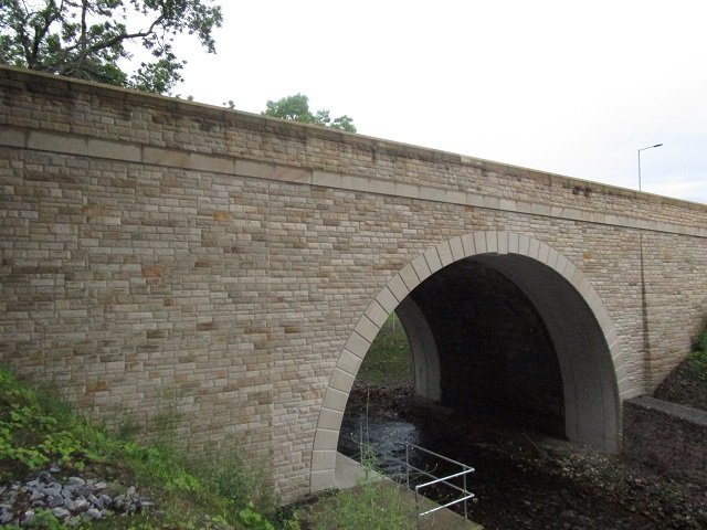 New Buff sandsotne Walling and Arch to New Bridge by Cumbrian Stone